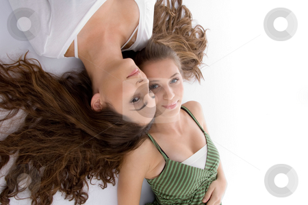Close up view young two cute friends stock photo, Close up view young two cute friends on an isolated white background by Imagery Majestic