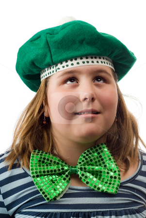 Saint Patricks Day stock photo, A young girl wearing a green hat and bowtie is looking up with her eyes, isolated against a white background by Richard Nelson