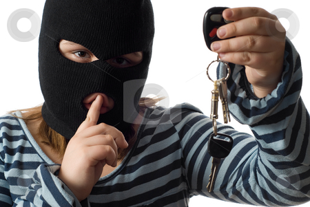 Child Stealing Car Keys stock photo, Closeup view of a child stealing some car keys, isolated against a white background by Richard Nelson