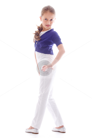 Fashion child with a strong pose stock photo, Young brunette child posing in different clothes by Frenk and Danielle Kaufmann