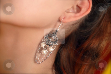 Earring stock photo, Luxury earring in young girl ear closeup by Julija Sapic