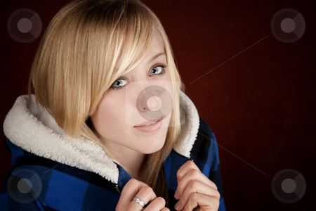 Pretty young girl stock photo, Pretty young blonde teenage girl in blue jacket by Scott Griessel