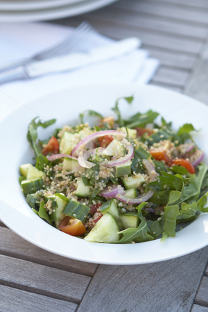 Couscous salad on outdoor table stock photo, Couscous salad on outdoor table by Gary Cookson