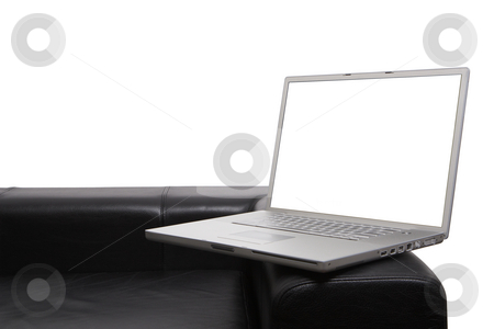Working at home concept stock photo, Laptop on modern couch isolated background and screen with clipping paths so you can insert your own items by Gary Cookson