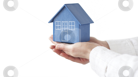 Buying your home stock photo, Model house held by female hands by Gary Cookson