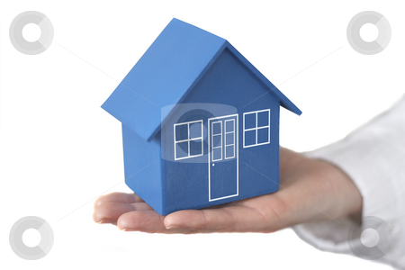 House in the palm of your hand stock photo,  by Gary Cookson