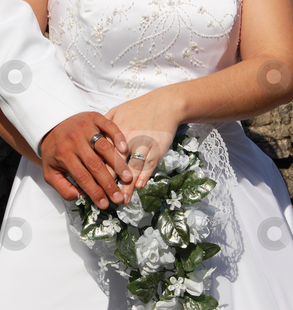 Wedding Day Couple stock photo, Happy newlyweds showing off their wedding rings by Crystal Srock