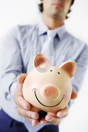 Business savings stock photo, Business amn holding fat,happy piggybank by Liv Friis-Larsen