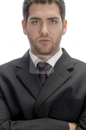 Businessman with folded hands stock photo, Businessman with folded hands looking to camera on an isolated white background by Imagery Majestic