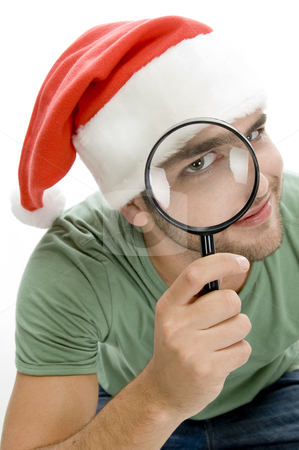 Man looking through lens stock photo, Man looking through lens on an isolated background by Imagery Majestic
