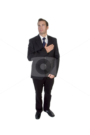 Standing businessman saluting by heart stock photo, Standing businessman saluting by heart on an isolated background by Imagery Majestic