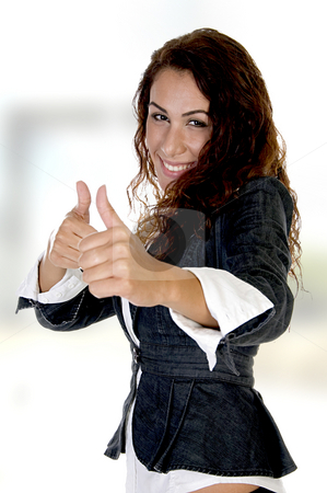 Woman showing thumb's up stock photo, Woman showing thumb's up on an abstract  background on an abstract  background by Imagery Majestic