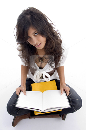 Female posing with her opened books stock photo, Female posing with her opened books with white background by Imagery Majestic