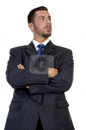 Smart businessperson with folded hands stock photo, Smart businessperson with folded hands on an isolated background by Imagery Majestic