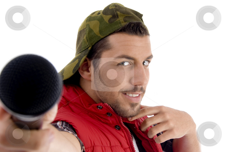 Young caucasian offering his microphone stock photo, Young caucasian offering his microphone with white background by Imagery Majestic