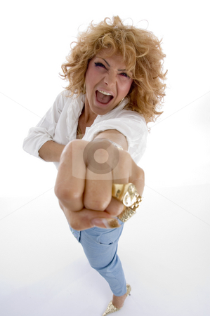 Shouting woman showing you punch stock photo, Shouting woman showing you punch on an isolated white background by Imagery Majestic