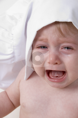 Crying little chef stock photo, Portrait of crying little baby chef by Imagery Majestic