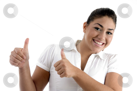 Smiling woman showing good luck gesture stock photo, Smiling woman showing good luck gesture against white background by Imagery Majestic