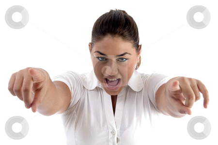 Shouting woman pointing with both hands stock photo, Shouting woman pointing with both hands on an isolated background by Imagery Majestic
