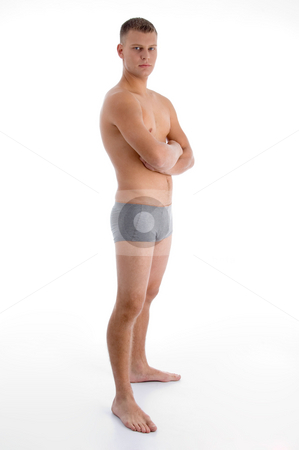 Side view of muscular man with crossed arms stock photo, Side view of muscular man with crossed arms on an isolated background by Imagery Majestic