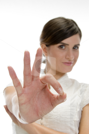 Lady showing ok sign stock photo, Lady showing ok sign on an isolated background by Imagery Majestic