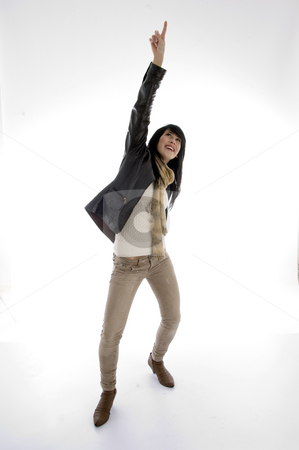 Woman pointing upwards stock photo, Woman pointing upwards isolated on white background by Imagery Majestic