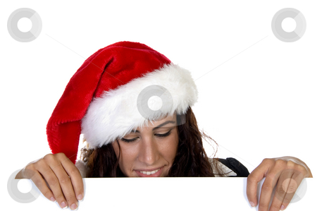Lady in christmas cap stock photo, Lady in christmas cap against white background by Imagery Majestic