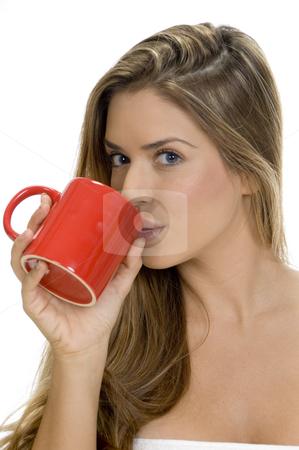 Lady drinking with coffee mug stock photo, Lady drinking with coffee mug by Imagery Majestic