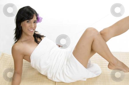White female laying on mat stock photo, White female laying on mat by Imagery Majestic