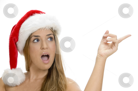 Indicating sexy lady with santa cap stock photo, Indicating sexy lady with santa cap by Imagery Majestic