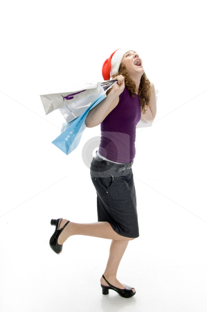 Cheerful lady holding carry bags stock photo, Cheerful lady holding carry bags with white background by Imagery Majestic