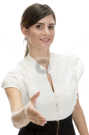 Young lady offering hand shake stock photo, Young lady offering hand shake with white background by Imagery Majestic