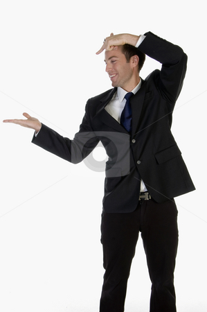 Man pointing on palm stock photo, Man pointing on palm on an isolated background by Imagery Majestic