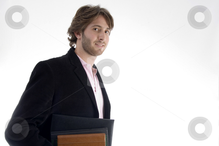 Handsome man holding files stock photo, Handsome man holding files on an isolated white background by Imagery Majestic