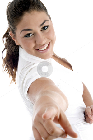 Smiling model pointing  stock photo, Smiling model pointing with white background by Imagery Majestic