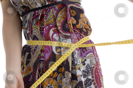 Female measuring her waist stock photo, Female measuring her waist isolated with white background by Imagery Majestic