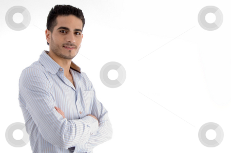 Brunette man with folded hands stock photo, Brunette man with folded hands on an isolated white background by Imagery Majestic