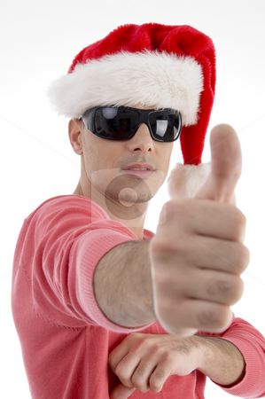 Handsome man with christmas hat wishing good luck stock photo, Handsome man with christmas hat wishing good luck on an isolated background by Imagery Majestic
