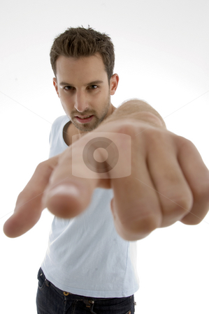 Young man pointing  stock photo, Young man pointing on an isolated white backgound by Imagery Majestic