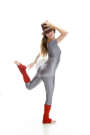 Woman trying to hold her leg stock photo, Woman trying to hold her leg on an isolated background by Imagery Majestic