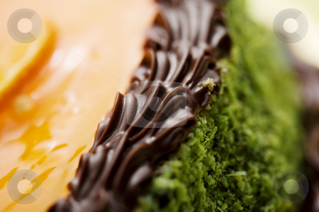 Cake detail stock photo, Closeup of detail on a beautiful cake with pistaccio, orange a chocolate,gateaux,decorative, by Liv Friis-Larsen