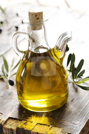 Olive oil stock photo, Bottle of pure fresh olive oil by Liv Friis-Larsen