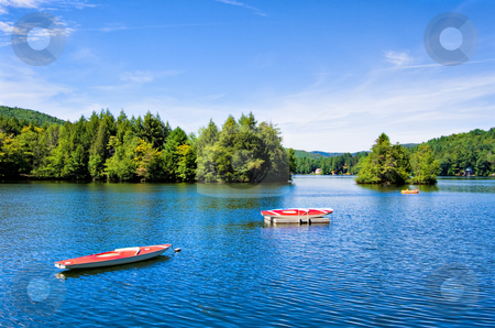 Mountain Lake stock photo, A lake in the mountains with small boats by Stephen Bonk