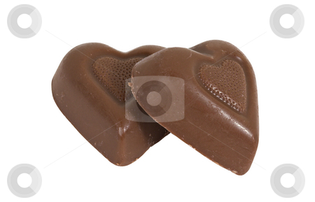 Two Chocolate Candy Hearts stock photo, Two chocolate candy hearts isolated over a white background by Stephen Bonk