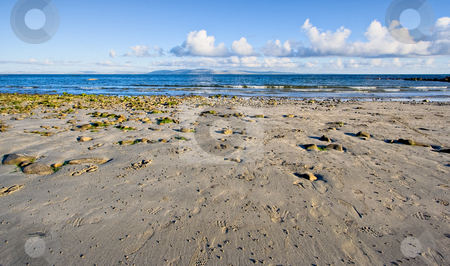 Galway Bay stock photo, Galway Bay in Ireland. The photo is layered with sand, water, The Burren (hills), and sky. by Stephen Bonk