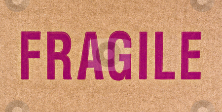 F-R-A-G-I-L-E stock photo, The word FRAGILE in red on a brown cardboard box. by Stephen Bonk