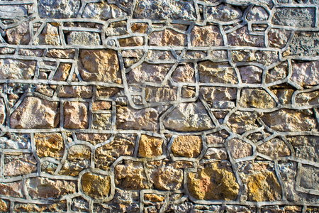 Stone Wall stock photo, Stone wall with much detail, patterns, and texture by Stephen Bonk