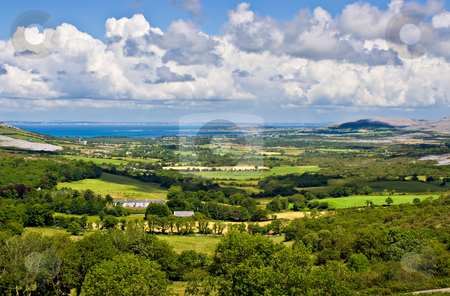 Ireland Landscape stock photo, Landscape of County Clare, Ireland. Green fields in foreground and Galway Bay in the background. Beginings of the Burren can also be seen. by Stephen Bonk
