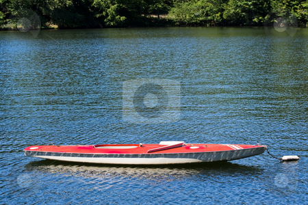 Boat on a Lake stock photo, A docked sunfish boat on a lake by Stephen Bonk