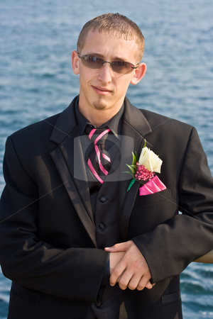 Teenager in a Tuxedo stock photo, Portrait of a teenage boy in a tuxedo. Background is a blue ocean. The teen is dressed for a high school prom but the photo could be used to represent any formal occasion. by Stephen Bonk